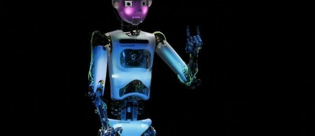 """Humanoid robot of British company RoboThespian """"blushes"""" during the opening ceremony of the Hanover technology fair Cebit March 9, 2014, where Britain is this year's partner country.     REUTERS/Wolfgang Rattay     (GERMANY - Tags: BUSINESS SCIENCE TECHNOLOGY"""