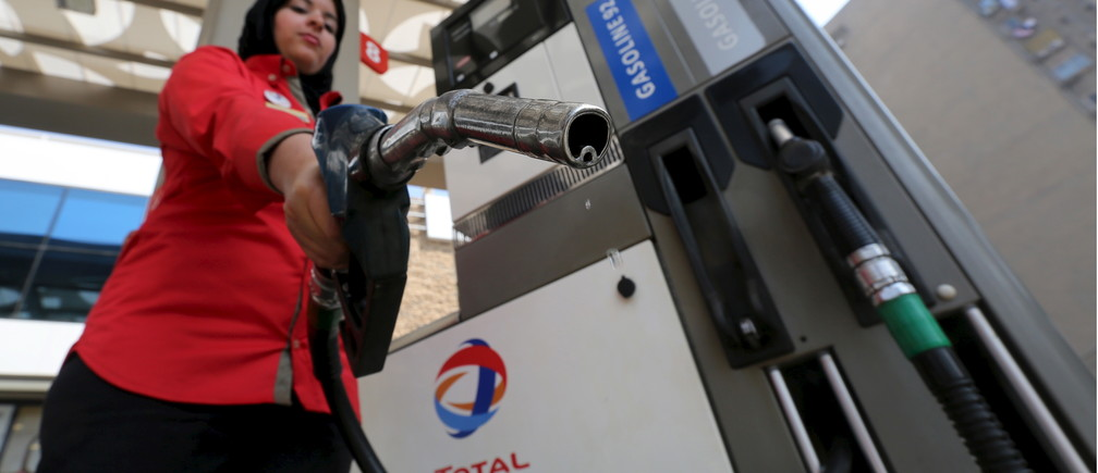 A female employee at a Cairo petrol station that has chosen to hire women – until recently, they were staffed almost exclusively by men.