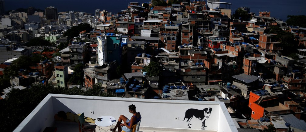 A woman sits on a terrace at Tiki hostel in Cantagalo favela, in Rio de Janeiro, Brazil, April 16, 2016.