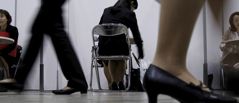 A female job seeker takes part in a job hunting counseling session with advisers during a job fair held for fresh graduates in Tokyo, Japan, March 20, 2016.   REUTERS/Yuya Shino/File Photo         GLOBAL BUSINESS WEEK AHEAD PACKAGE       SEARCH BUSINESS WEEK AHEAD JULY 4 FOR ALL IMAGES? - RTX2JK5X