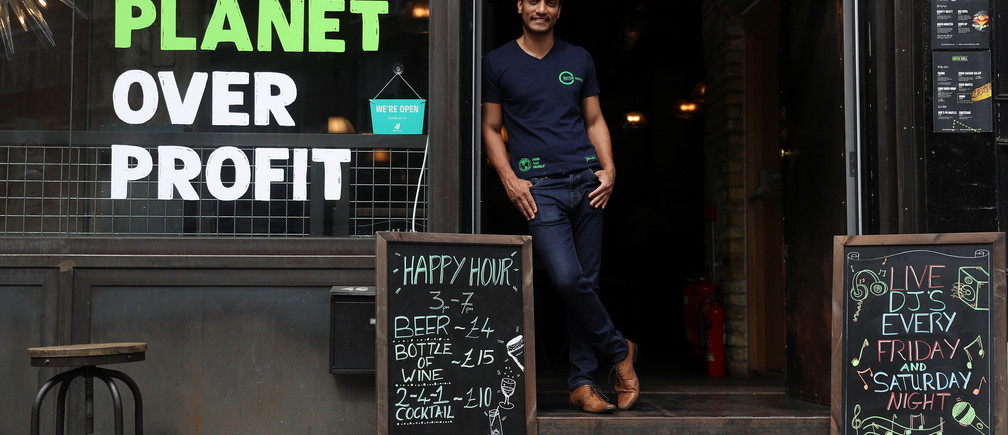 Randy Rampersand, founder of the Green Vic, who is aiming to create the world's most ethical pub, poses for a photograph in Shoreditch, London, Britain July 5, 2019. Picture taken July 5, 2019. REUTERS/Simon Dawson - RC1A11078C00