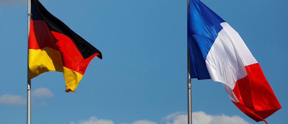 The flags of Germany and France are seen in front of the the Chancellery, before the meeting between German Chancellor Angela Merkel and French President Emmanuel Macron in Berlin, Germany May 15, 2017. REUTERS/Pawel Kopczynski - RC1BF335E170
