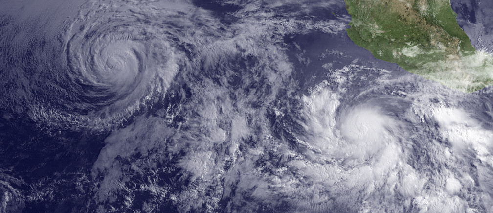 Hurricane Andres (L) is seen weakening as Tropical Storm Blanca strengthens off the coast of Baja California, Mexico, as seen in this image from NOAA's GOES West satellite taken at 11:00 am EDT (15:00 GMT) June 2, 2015.  REUTERS/NOAA/Handout  THIS IMAGE HAS BEEN SUPPLIED BY A THIRD PARTY. IT IS DISTRIBUTED, EXACTLY AS RECEIVED BY REUTERS, AS A SERVICE TO CLIENTS. FOR EDITORIAL USE ONLY. NOT FOR SALE FOR MARKETING OR ADVERTISING CAMPAIGNS - TM3EB620YOM01