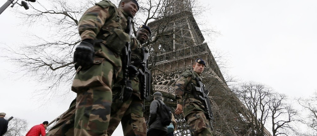 "French soldiers patrol near the Eiffel Tower in Paris as part of the ""Vigipirate"" security plan December 23, 2014."