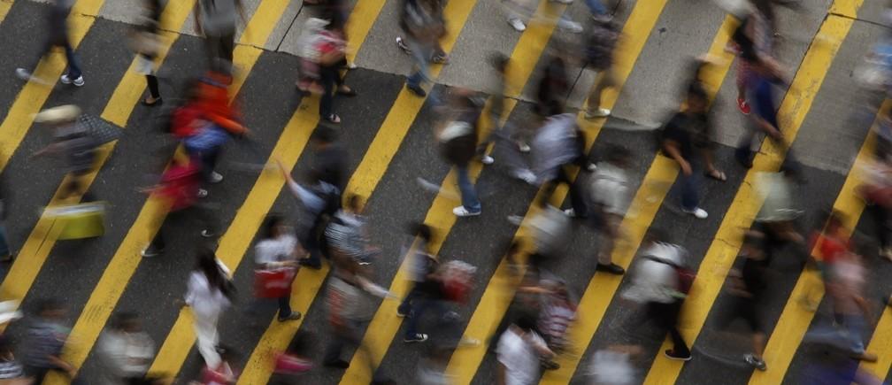 People cross a street in Mong Kok district in Hong Kong, October 4, 2011.