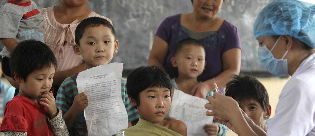 A student receives a measles vaccination at a primary school in Luoyang, Henan province September 11, 2010.