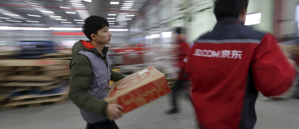 Employees work at a JD.com logistic centre in Langfang, Hebei province, November 10, 2015.