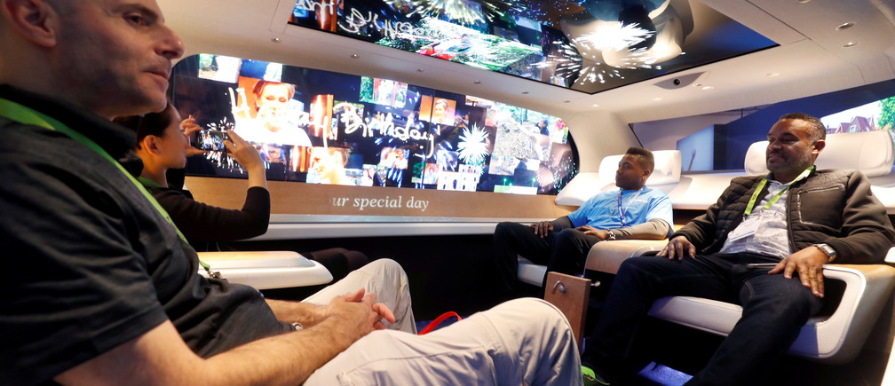 Attendees check out the Panasonic SPACe_L Autonomous Cabin, a concept interior for a luxury autonomous vehicle, during the 2019 CES in Las Vegas, Nevada, U.S. January 9, 2019. REUTERS/Steve Marcus - RC1CC74F1D10