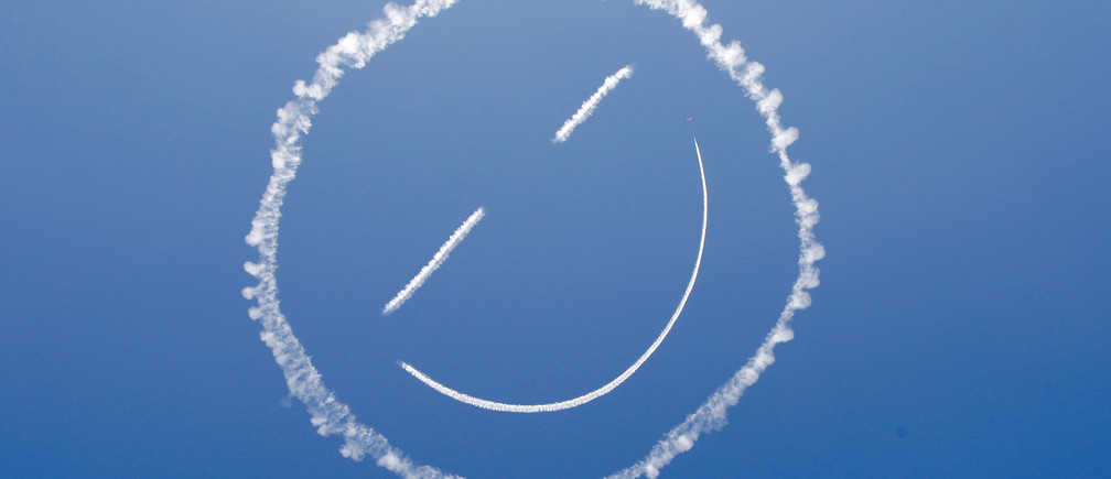 A sky writer draws a smiley face in the sky at the start of the Los Angeles County Air Show at the General William J. Fox Airfield in Lancaster, California, March 21, 2014. REUTERS/David McNew (UNITED STATES - Tags: MILITARY SOCIETY TRANSPORT) - GM1EA3M0QXE01