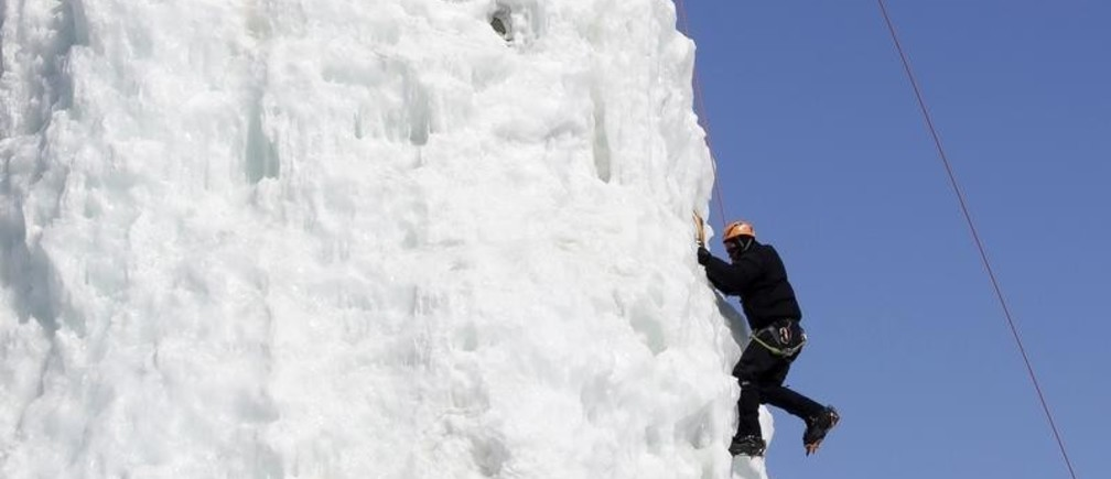 A man climbs an ice column at the Climbing Club of St. Boniface in Winnipeg, Manitoba, March 27, 2014. The pursuit of winter activities continues with temperatures several degrees below low normal for this time of year according to Environment Canada. REUTERS/Lyle Stafford (CANADA - Tags: ENVIRONMENT SPORT) - GM1EA3S06Z801