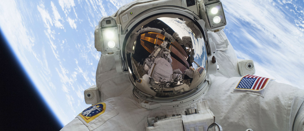 Astronaut Mike Hopkins, Expedition 38 Flight Engineer, is shown in this handout photo provided by NASA as he participates in the second of two spacewalks which took place on December 24, 2013, released on December 27, 2013. The scheduled spacewalks were designed to allow the crew to change out a faulty water pump on the exterior of the Earth-orbiting International Space Station. He was joined on both spacewalks by NASA astronaut Rick Mastracchio, whose image shows up in Hopkins' helmet visor. REUTERS/NASA/Handout via Reuters space travel space aerospace nasa astronaut science the moon artemis apollo mission international space station  iss astronaut  science physics solar system sun travel endeavor
