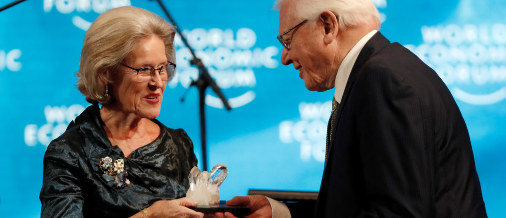 Naturalist Sir David Attenborough receives a Crystal Award from Hilde Schwab, Chairperson and Co-Founder of Schwab Foundation for Social Entrepreneurship, during an opening ceremony of the World Economic Forum (WEF) in Davos, Switzerland, January 21, 2019. REUTERS/Arnd Wiegmann - RC15C3F82550