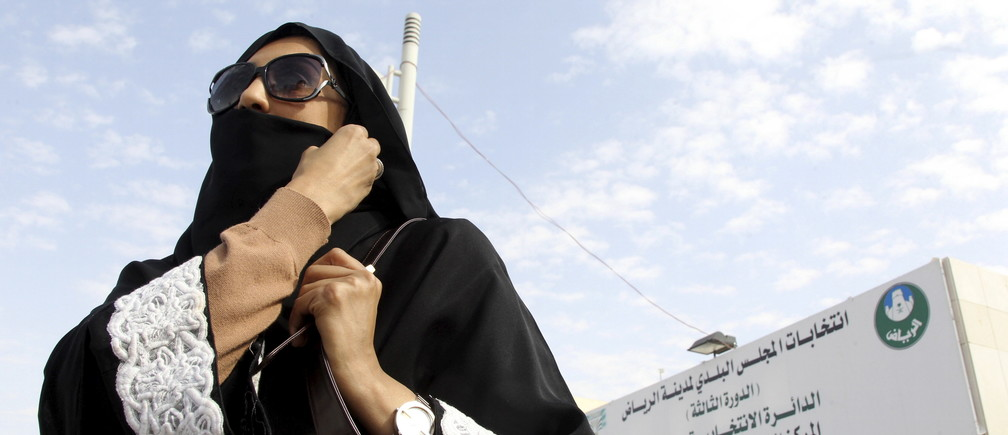 A Saudi woman leaves a polling station after casting her vote during municipal elections, in Riyadh, Saudi Arabia December 12, 2015.