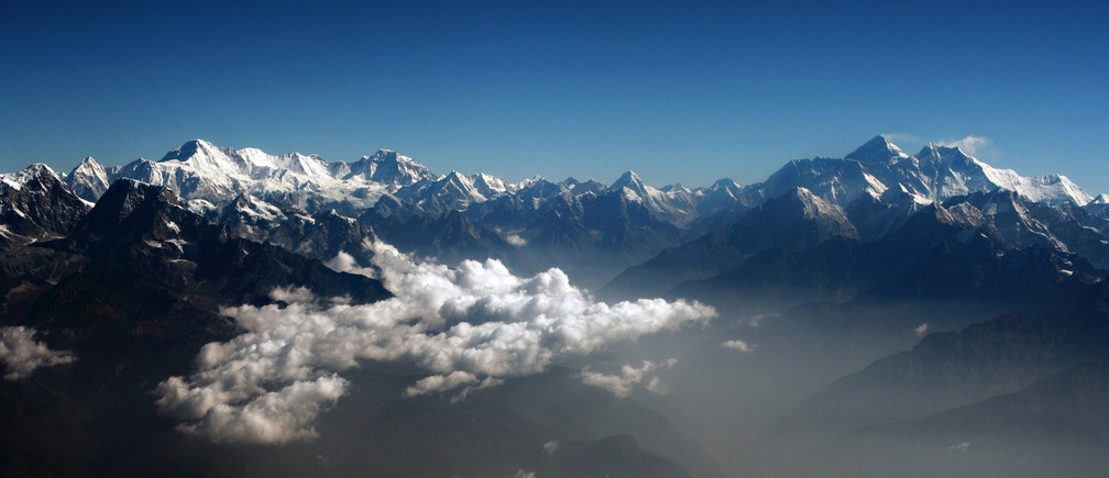 Mount Everest (2nd R), the world highest peak, and other peaks of the Himalayan range are seen from air during a mountain flight from Kathmandu April 24, 2010. REUTERS/Tim Chong (NEPAL - Tags: ENVIRONMENT TRAVEL) - RTR2RWME