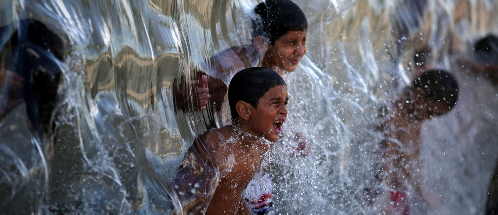 Children play with water in Madureira Park in Rio de Janeiro, Brazil.