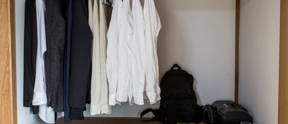 "Clothes hang in the wardrobe of minimalist Katsuya Toyoda in Tokyo, Japan, March 5, 2016. REUTERS/Thomas Peter SEARCH ""MINIMALISM"" FOR THIS STORY. SEARCH ""THE WIDER IMAGE"" FOR ALL STORIES - S1AETKWNEPAD"