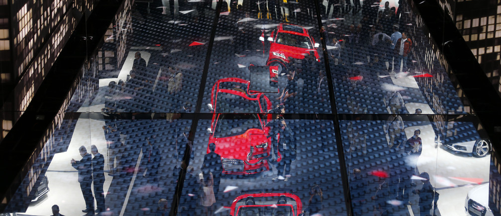 The stand of German car manufacturer Audi is reflected in the ceiling during a media preview day at the Frankfurt Motor Show (IAA) September 11, 2013. The world's biggest auto show is open to the public September 14 -22.   REUTERS/Kai Pfaffenbach (GERMANY - Tags: TRANSPORT BUSINESS) - BM2E99B10PQ01