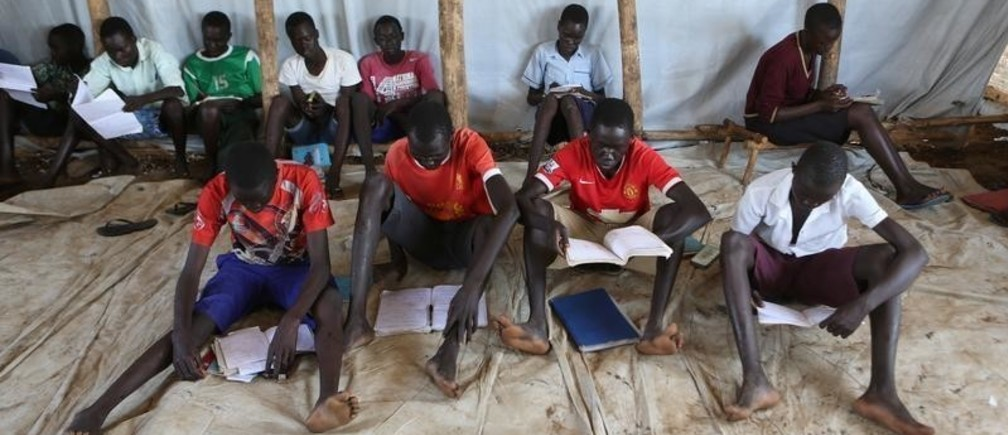 Youth who fled fighting in South Sudan attend classes in a tent at Bidi Bidi refugee's resettlement camp near the border with South Sudan, in Yumbe district, northern Uganda December 7, 2016. REUTERS/James Akena