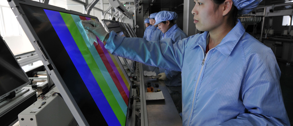 Employees clean and test newly made screens of LED televisions along a production line at a factory of Rizhao Hidear Electronics Co. Ltd in Rizhao, Shandong province March 1, 2011. Chinese manufacturing grew at its slowest pace in at least half a year in February, according to a pair of surveys, as the government's sustained campaign to tame inflation weighed on industrial activity. REUTERS/Stringer (CHINA - Tags: SCI TECH BUSINESS) CHINA OUT. NO COMMERCIAL OR EDITORIAL SALES IN CHINA - GM1E7311EMG01