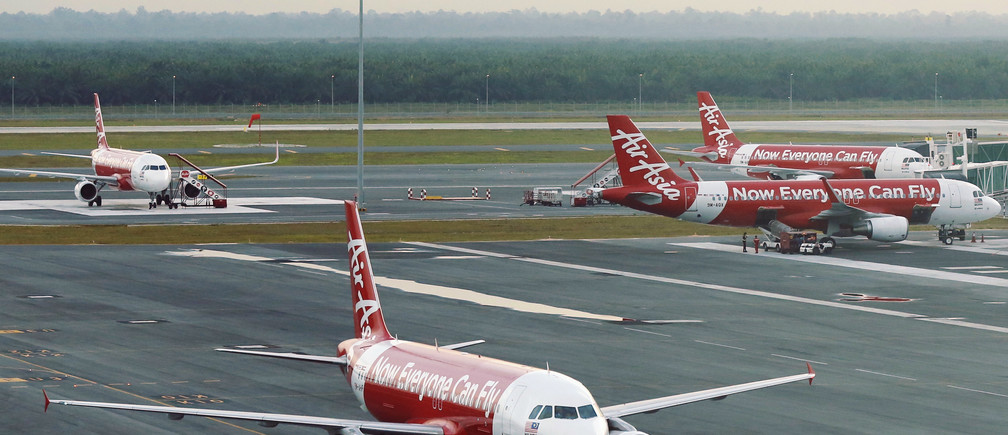 AirAsia planes are seen on the runway at Kuala Lumpur International Airport August 19, 2014.