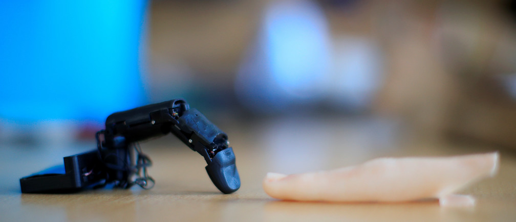 The robot finger 'MobiLimb' that attaches to a mobile phone, invented by Marc Teyssier, a PhD student at Telecom Paris Tech Engineering school, is displayed after an interview with Reuters in Paris, France October 9, 2018. Picture taken on October 9, 2018. REUTERS/Gonzalo Fuentes - RC11132D5060