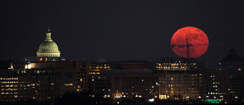 The Moon is seen as is rises in Washington, D.C., U.S. in this December 3, 2017 handout photo.  The full Moon is the first of three consecutive supermoons. The two will occur on Jan. 1 and Jan. 31, 2018. A supermoon occurs when the moon's orbit is closest (perigee) to Earth at the same time it is full.  Bill Ingalls/NASA/Handout via REUTERS     ATTENTION EDITORS - THIS IMAGE WAS PROVIDED BY A THIRD PARTY.    MANDATORY CREDIT. - RC11307D30A0