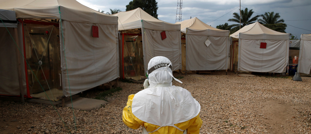 A health worker wearing Ebola protection gear, walks before entering the Biosecure Emergency Care Unit (CUBE) at the ALIMA (The Alliance for International Medical Action) Ebola treatment centre in Beni, in the Democratic Republic of Congo, March 30, 2019. Picture taken March 30, 2019.REUTERS/Baz Ratner - RC1A0066F940