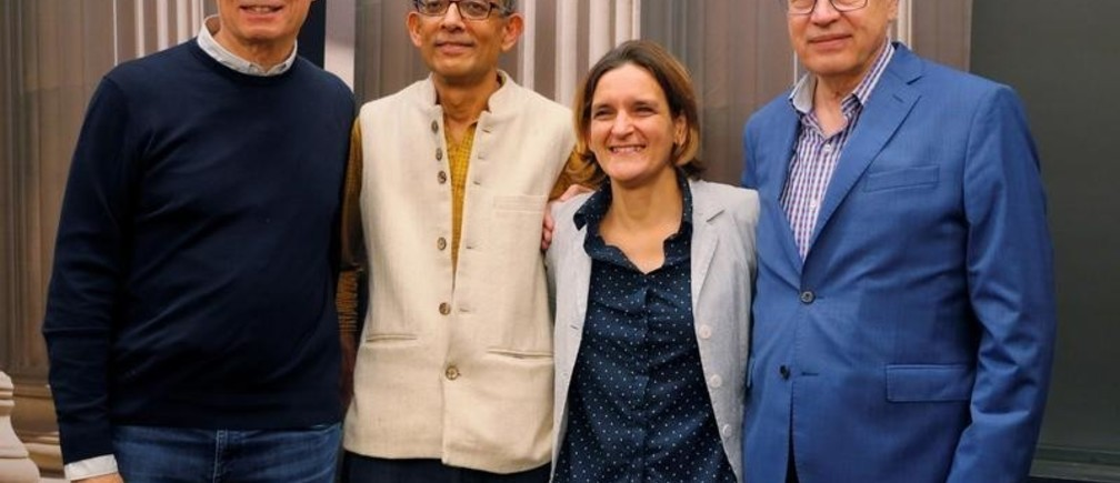 Abhijit Banerjee and Esther Duflo, two of the three winners of the 2019 Nobel Prize in Economics, pose for a photograph with 2016 Nobel Prize in Economics laureate Bengt Holstrom and 2014 laureate Jean Tirole at the Massachusetts Institute of Technology (MIT) in Cambridge, Massachusetts, U.S., October 14, 2019.     REUTERS/Brian Snyder - RC1889161B00