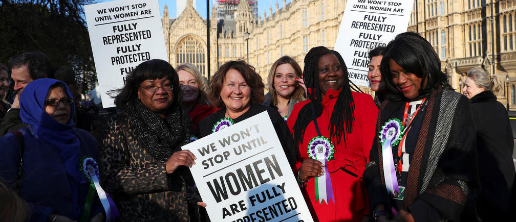 British members of Parliament attend an event to mark the 100th anniversary of the enfranchisment of some, but not all, women