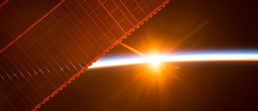 A photo taken on July 26, 2017 by a member of the Expedition 52 crew aboard the International Space Station shows one of the 16 sunrises they experience every day while orbiting Earth. One of the solar panels that provides power to the station is seen in the upper left. NASA/Handout via REUTERS    ATTENTION EDITORS - THIS IMAGE WAS PROVIDED BY A THIRD PARTY - RC180E6A5D10