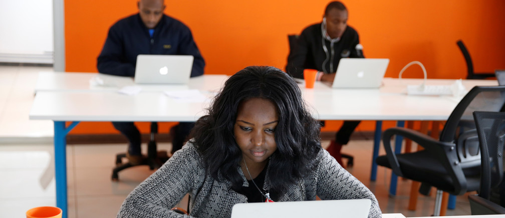 An employee of tech start-up Sendy, which offers online logistics services, works on her computer at their office in Nairobi, Kenya, October 30, 2018. Picture taken October 30, 2018. REUTERS/Baz Ratner - RC1FE1B5F060