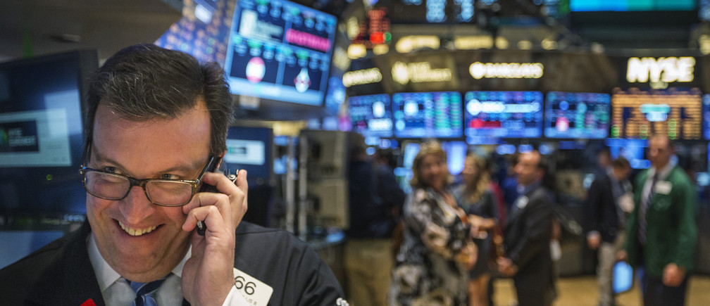 A trader works on the floor of the New York Stock Exchange shortly before the end of the day's trading in New York July  america usa us united states women business businesswoman businessman corporation corporate finance wall street stock exchange capitalism private ownership board c-suite CEOs CFOs corporation united states us america wall street change gender parity equality goldman sachs davos industry representation fair finance fiscal financial economics economies trading trade price money profit value men male female change changing 2020 future taxation tax wealth gross domestic product gdp