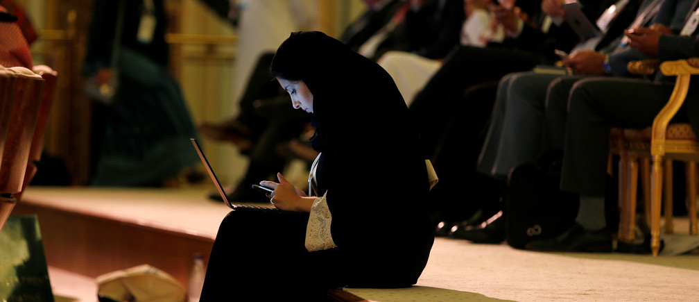 A woman uses her laptop during the Future Investment Initiative conference in Riyadh, Saudi Arabia October 24, 2017. REUTERS/Hamad I Mohammed - RC18FAB18AC0
