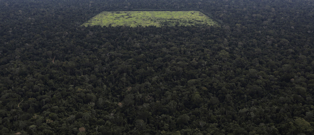 An aerial view shows a tract of Amazon rainforest which has been cleared by loggers and farmers for agriculture, near the city of Santarem, Para State April 20, 2013. The Amazon rainforest is being eaten away at by deforestation, much of which takes place as areas are burnt by large fires to clear land for agriculture. Initial data from Brazil's space agency suggests that destruction of the vast rainforest - the largest in the world - spiked by more than a third over the past year, wiping out an area more than twice the size of the city of Los Angeles. If the figures are borne out by follow-up data, they would confirm fears of scientists and environmental activists who warn that farming, mining and Amazon infrastructure projects, coupled with changes to Brazil's long-standing environmental policies, are reversing progress made against deforestation. Environmental issues will be under the spotlight as a United Nations Climate Change Conference opens in Warsaw, Poland, on November 11. Picture taken on April 20, 2013. REUTERS/Nacho Doce (BRAZIL - Tags: AGRICULTURE POLITICS ENVIRONMENT) ATTENTION EDITORS: PICTURE 02 OF 55 FOR PACKAGE 'AMAZON - FROM PARADISE TO INFERNO' TO FIND ALL IMAGES SEARCH 'AMAZON INFERNO' - RTX158ZG