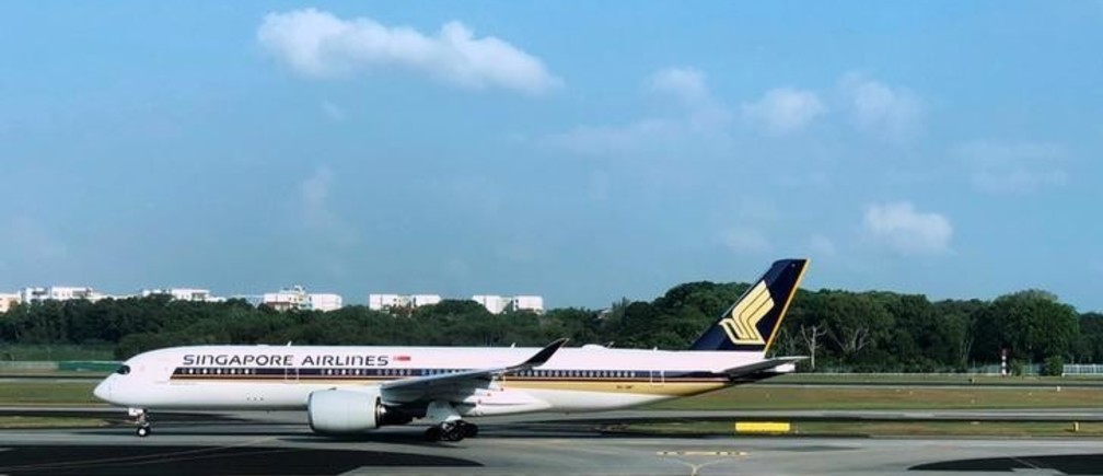 A Singapore Airlines (SIA) Airbus A350-900 passenger aircraft taxis to a gate at Changi Airport in Singapore April 9, 2018. REUTERS/Tim Chong
