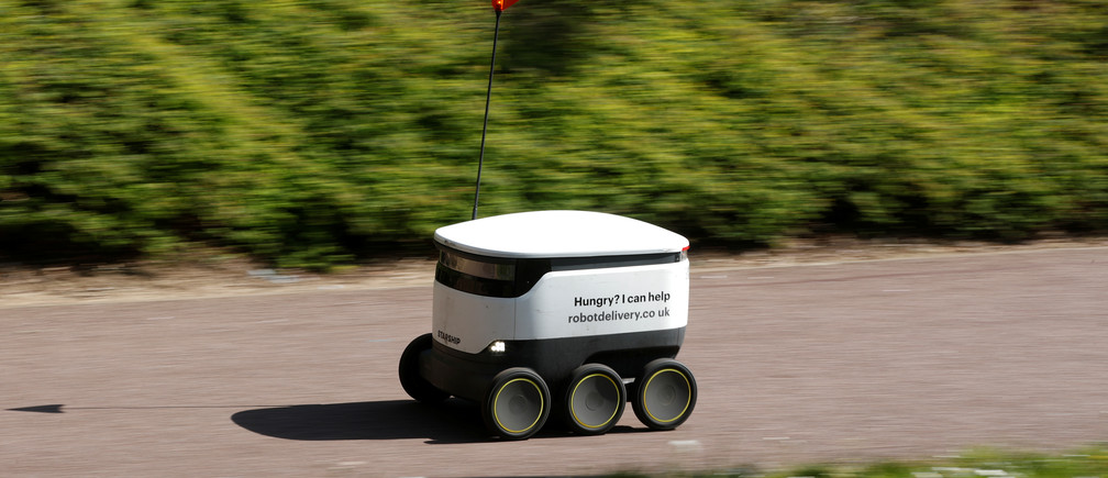 A delivery robot from the company ''Starship'' is seen, as the spread of the coronavirus disease (COVID-19) continues, in Milton Keynes, Britain, April 21, 2020. REUTERS/Andrew Boyers - RC229G9I2E2O
