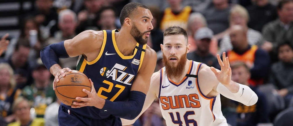 Feb 24, 2020; Salt Lake City, Utah, USA; Utah Jazz center Rudy Gobert (27) protects the ball from Phoenix Suns center Aron Baynes (46) during the third quarter at Vivint Smart Home Arena. The Suns won 131-111. Mandatory Credit: Chris Nicoll-USA TODAY Sports - 14092919