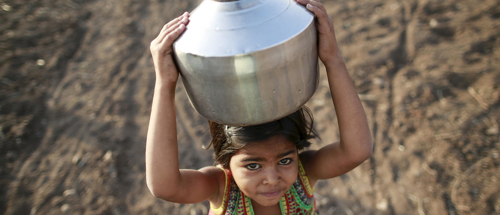 Child carrying water India drought.