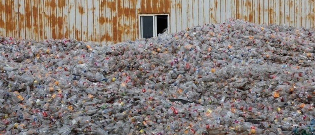 Plastic bottles are stocked to be recycled at the Weeco plastic recycling factory at the Athi River industrial zone near Nairobi, Kenya, May 15, 2019. Picture taken May 15, 2019. REUTERS/Baz Ratner - RC1CF1A1AF60