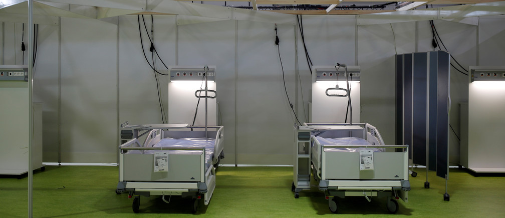 "Beds are seen at the ""Corona Treatment Center Jaffestrasse"" makeshift hospital being set up at the fairgrounds to treat patients following an outbreak of the coronavirus disease (COVID-19), in Berlin, Germany April 23, 2020. Odd Andersen/Pool via REUTERS - RC2FAG9INJ5H"