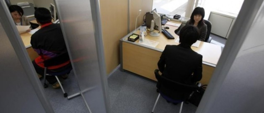 A Japanese new graduate, who wishes to be called Shinji (R), speaks with a counsellor inside a compartment at Tokyo Metropolitan Government Labor Consultation Center in Tokyo in this April 8, 2010 file photo. Japan already has one Lost Generation of youth stuck in insecure jobs as part-timers, contract workers and temps after failing to find steady employment when they graduated from high school or college during a hiring Ice Age from 1994 to 2004. Now the country's leaders worry that a still-fragile recovery from Japan's worst recession in 60 years and cautious corporate hiring plans are putting a second batch of youth at risk, raising prospects of a further waste of human resources the country can ill afford as it struggles with an ageing, shrinking population. Picture taken April 8, 2010. To match feature JAPAN-GENERATION/