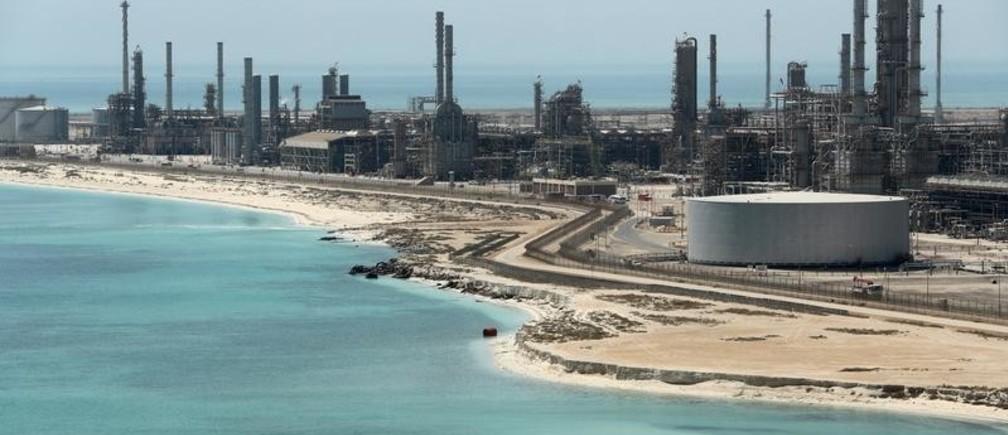 An Aramco employee walks near an oil tank at Saudi Aramco's Ras Tanura oil refinery and oil terminal in Saudi Arabia May 21, 2018.