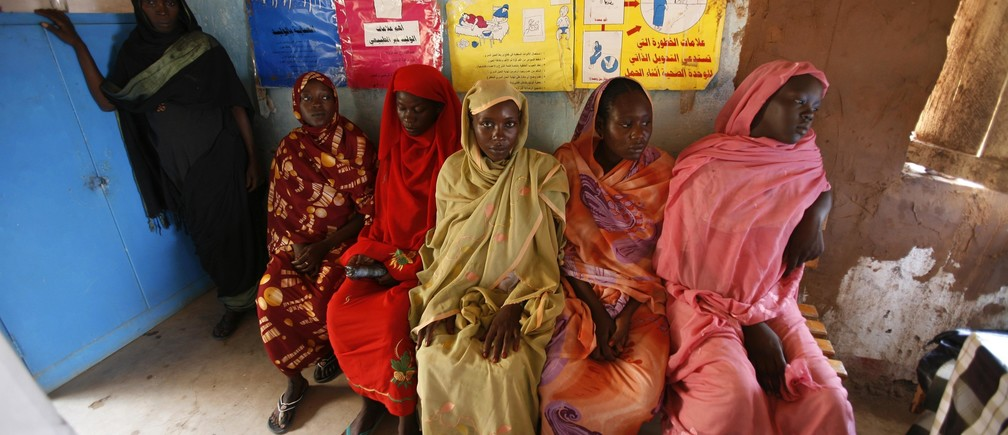 Pregnant women wait to have a medical check-up at the Mayo camp for internally displaced persons in Khartoum September 6, 2007.