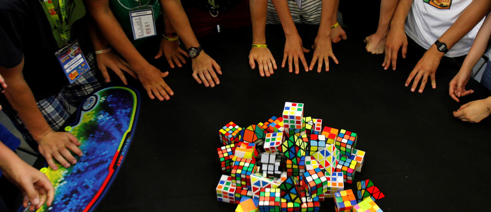 Competitors concentrate before solving Rubik's cubes during the Rubik's Cube European Championship in Prague, Czech Republic, July 17, 2016. REUTERS/David W Cerny - S1AETQDKNIAA