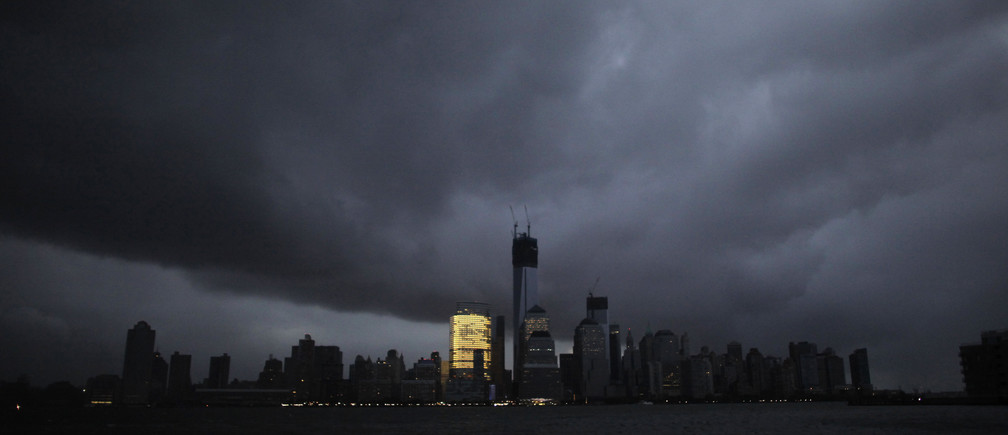 "The skyline of lower Manhattan,  as seen from Exchange Place, is mostly in darkness except for the Goldman Sachs building after a preventive power outage caused by giant storm Sandy, in New York October 30, 2012. Millions of people in the eastern United States awoke on Tuesday to flooded homes, fallen trees and widespread power outages caused by Sandy, which swamped New York City's subway system and submerged streets in Manhattan's financial district. More than two-thirds of the U.S. East Coast's refining capacity was shut down and fuel pipelines idled due to Hurricane Sandy. Early assessments show the region's biggest plants may have escaped without major damage. REUTERS/Eduardo Munoz (UNITED STATES - Tags: ENVIRONMENT DISASTER ENERGY CITYSPACE TPX IMAGES OF THE DAY) FOR BEST QUALITY IMAGE ALSO SEE: GM1E8BU19QD01.  FOR EDITORIAL USE ONLY. NO COMMERCIAL SALES WORLDWIDE UNTIL JANUARY 7, 2018. FOR MORE INFORMATION, PLEASE CONTACT YOUR CONTACT YOUR LOCAL SALES REPRESENTATIVE"". - GM1E8AU1K3201"