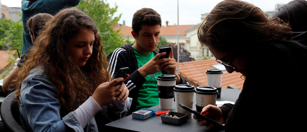 People use their mobile phones at a cafe in central Istanbul, Turkey May 18, 2017. Picture taken May 18, 2017. REUTERS/Murad Sezer - RTS19L4E