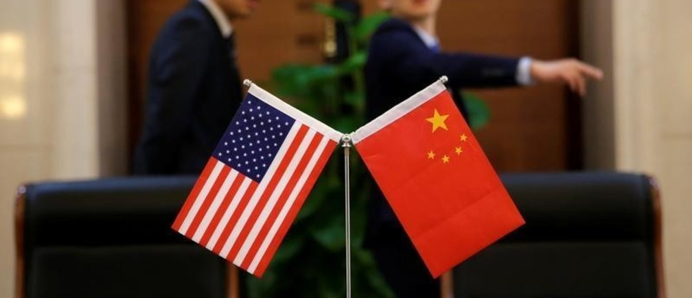 Chinese and US flags are set up for a signing ceremony during a visit by U.S. Secretary of Transportation Elaine Chao at China's Ministry of Transport in Beijing, China April 27, 2018. Picture taken April 27, 2018. REUTERS/Jason Lee - RC13D78E0020