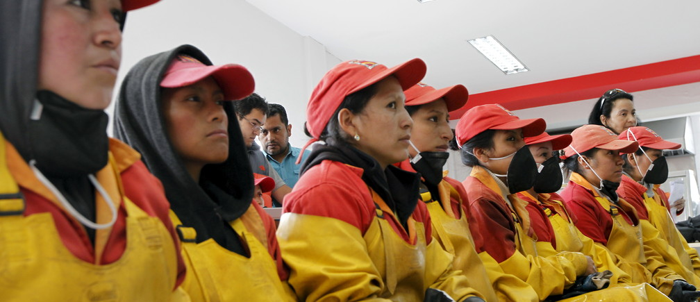 Female workers at a flower farm are seen at the Quito Inor Flowers company in Boliche, Ecuador