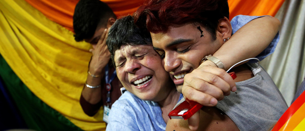 People belonging to the lesbian, gay, bisexual and transgender (LGBT) community celebrate after the Supreme Court's verdict of decriminalizing gay sex and revocation of the Section 377 law, at an NGO in Mumbai, India, September 6, 2018. REUTERS/Francis Mascarenhas - RC1CF1737F80