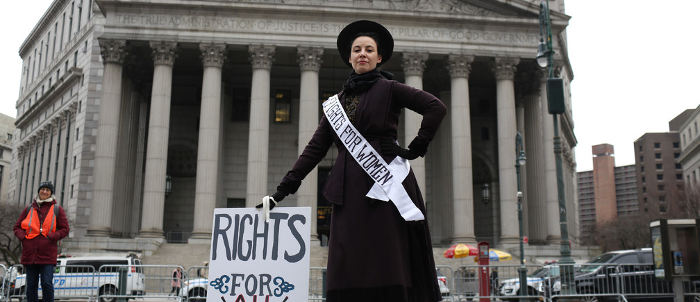 Amy Winn, 44, poses for a portrait representing 100 years of women's suffrage at the Women's Unity Rally, in front of the New York Supreme Court in Manhattan, in New York City, New York, U.S., January 19, 2019. REUTERS/Gabriela Bhaskar - RC1EE615D110